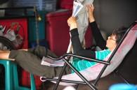 Older lady reading newspaper